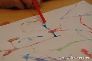 blowing through a straw to create art