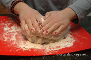 kneading the dough by hand