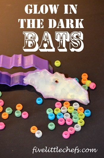 Glow in the dark bats made with pony beads and fishing line perfect for #Halloween from fivelittlechefs.com #bats