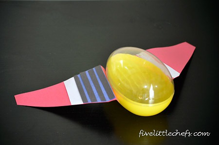 Using a large plastic egg, some colored paper, popsicle sticks and glue you can make a spaceship like Meet The Robinsons, Little Einsteins, The Jetsons.
