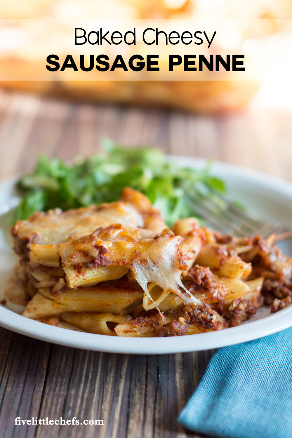 Baked Cheesy Sausage Penne is ultimate comfort foods. Use penne pasta, italian sausage and lots of mozzerella cheese to make it as cheesy as you want. Dinner is easy on the table within an hour, making for a great weeknight meal.