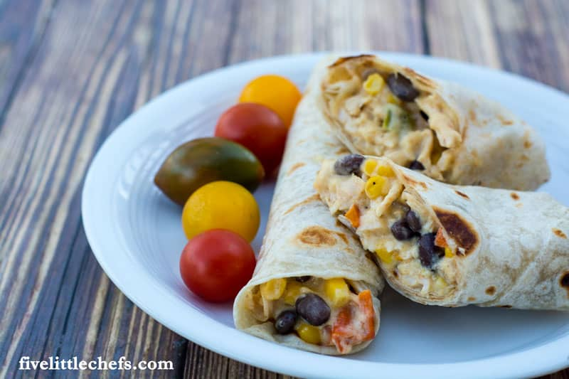 Easy chicken burrito recipe is made with frozen vegetables from the freezer, shredded cheese and rotisserie chicken. This recipe can be completed easily within 30 minutes.