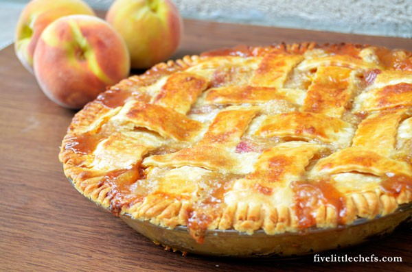 This easy peach pie can be in the oven within 15 minutes. Use fresh peaches and a premade pie crust. Your guests will ask for the recipe!