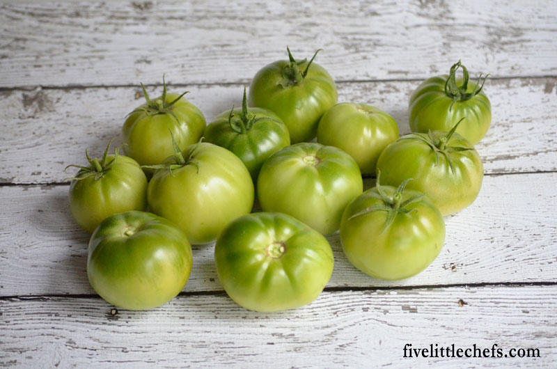 Tips on how to ripen green tomatoes indoors just before the frost is about to hit the vines.